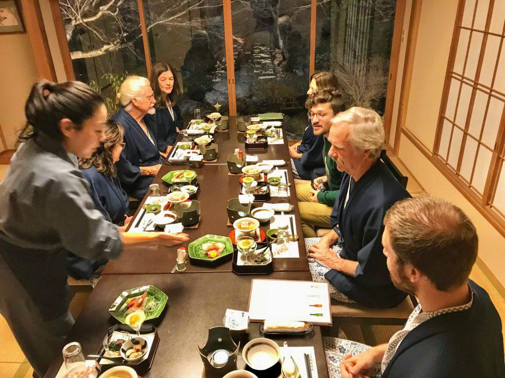 The waitress introducing the next course of fresh Sashimi.