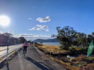Cycling along the Lake Biwa Ichi Cycling Route.