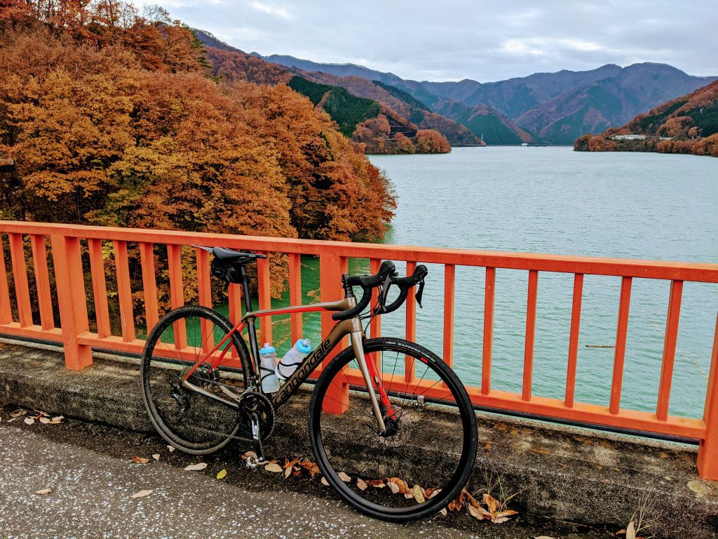 The bold fall colors from the red bridge of Lake Kusaki.