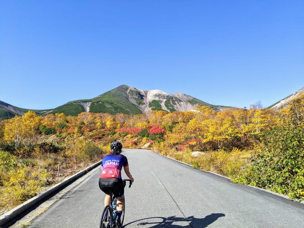 Cycling to the top of Mt Norikura in peak fall colors, Koyo in Japanese.