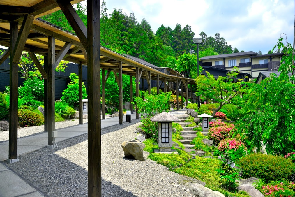 The beautiful courtyard of a ryokan on the Valleys and Volcanoes Tour.