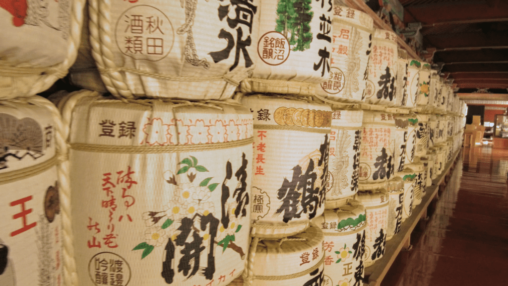 Local sake barrels donated to the kami gods of the mountains & rivers that feed the rice fields below.